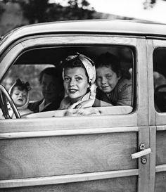 Rita Hayworth with her daughters Rebecca and Yasmina leaving Chateau de l'Horizon, property of Aly Khan. Golfe-Juan 1951.