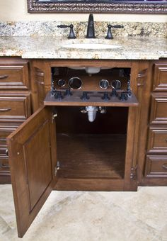 Clean Counters, This remodel focuses on bringing a spa feeling to the home. We achieved this by using the POJJO Vanity Valet Secret to create space to efficiently store and use all hair appliances. This system allows the client to heat and cool down their flat irons and curling irons inside unused space...without sacrificing any cabinet room. www.pojjo.com, No space is sacrificed. In fact, using the VVS - Secret, creates new space. The drawer that was used to store these appliances is not…