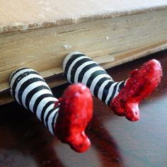 Make these wicked witch legs from dough and attach them onto paper to create a one-of-a-kind bookmark. Source: Facebook user Oops I Craft My Pants