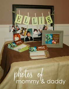 Centerpiece Table Baby Boy Outfits | table at the entrance with photos of the mommy & daddy-to-be clothes ...