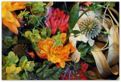 """Playing with textures. Bridal boquet had fragrant white freesia, coral and orange dahlias, origanum """"Kent Beauty,"""" succulent cuttings, white lisianthus, dusty miller, echinops ritro, blue eryngium, and a large tillandsia xeographica."""