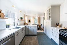 Love floor to ceiling cupboards with glass doors on top