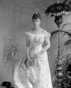 Queen Mary (1867-1953) when Princess Victoria Mary of Teck prior to wedding, July 6, 1893. Consort of King George V. Wearing Diamond rivière necklace a gift from King Edward VII and Queen Alexandra in memory of the Duke of Clarence, who died February 27, 1892. May, as she was to be known, was originally engaged to the Duke (Prince Albert Victor), eldest son of the then Prince of Wales and Alexandra. He died 6 weeks before the wedding. She was soon engaged to and married his brother.