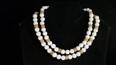 milk glass beaded 1960s necklace with rich nibbed gold tone stations