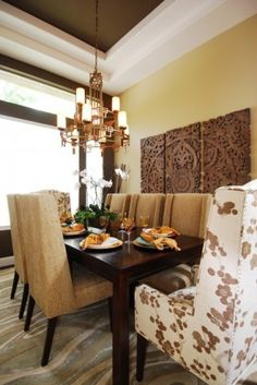 Great dining space!  Love the wood panels and the white/floral chairs.  Oh, and the ceiling too!