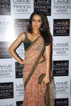 Shraddha Kapoor in a fragrant Sabyasachi sari styled by Nisha Kundnani of Bridelan India