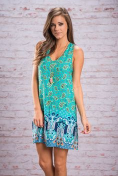This dress is amazing any time of day.... just like mimosas! The wild paisley print is so much fun especially in all those colors! But that strappy back is what will really make you fall in love! This gem is lined just to keep everything smooth and covered!