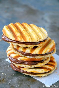 Nutella Waffle Sandwich Cookies - these are just ridiculous. The first ingredient on the list is 1 cup of heavy cream and they take 1.5 cups of powdered sugar. And they're made in a toastie press. It's insane. #desserts #snacks