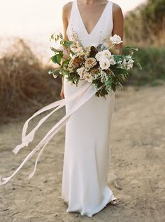 bride and her bouquet captured at sunset