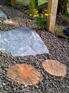 Garden path stones and wood. MLS