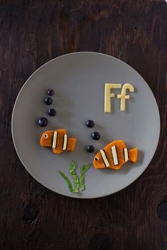 Sweet potato fish are part of our Alphabet Kid Snack series of healthy toddler snacks that make learning fun. Your child will love this cute kid snack! Get more cute kid snacks at http://EatingRichly.com