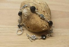 Check out this item in my Etsy shop https://www.etsy.com/listing/218173184/garnet-bracelet-flower-bracelet-crystal