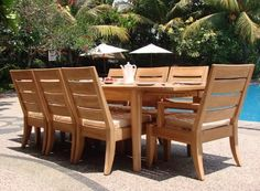 "Grade-A Teak Wood luxurious 9 pc Dining Set : 109"" Rectangle Table, 6 Armless and 2 Arm / Captain Chairs [Model:SB] by TeakStation. $3699.99. Table comes with 2"" umbrella hole. Dim: 78"" L(no extension) and 109.5"" L(with extension), 42.5"" W , 29.5"" H.. You can lengthen the table with minimal effort by simply opening the butterfly leaf extensions.. ADD SUNBRELLA FABRIC CUSHIONS BY SEARCHING ""Teakstation Dining Cushion"" ON AMAZON, CUSTOM MADE FOR THESE STYLE CHAIRS. 9p..."