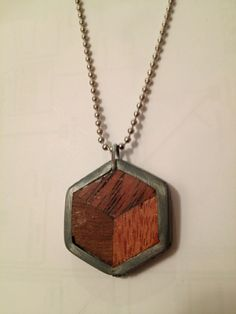 A hexagon pendant I made from scrap wood and a retired nut from a vintage bike