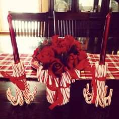 My Christmas centerpiece 2013  candy canes and roses. Simply hot glued candy canes to a tin can to make the vase and directly to the candles