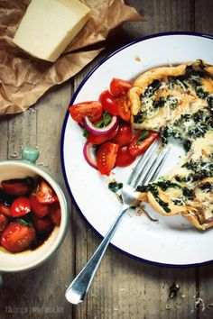 kale, red onion and parmesan omelette with tomato salad.