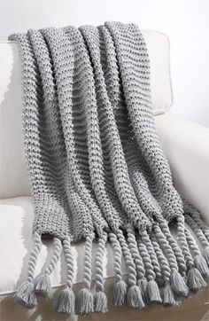 Cozy, chunky and the perfect color to go on the sofa this fall.   $68