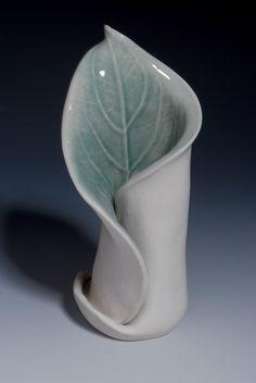 "Handbuilt porcelain vase using a hosta leaf from my shade garden, Glazed with a watertight glossy celedon glaze.  size 6""x3""x 2 1/2"""