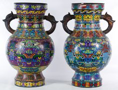 Lot 464: Asian Cloisonne Vases; A pair of contemporary vases with stylized symbols and two handles each