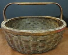 "LARGE EARLY AMERICAN PRIMITIVE BASKET NOTCHED HANDLE~This is an all original outstanding primitive 1800's era LARGE 'Fruit Gathering' Basket. The basket has a wonderful patina with a very strong carved notched handle. The size is 18: x 11 1/2"", and really a fabulous and authentic basket!....~♥~"