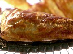 """Chicken Pot Pie Turnovers from FoodNetwork.com. AWESOME ratings. Pot pies in puff pastry """"pockets"""". The filling can be made with rotisserie chicken, and includes white wine. YUM. Very """"company worthy"""" recipe according to the reviews! Impressive but easy."""