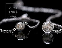 With lots of love and made by hand Brass chain in silver with dandelion taken in a mini glass globe who come here with the matching bracelets