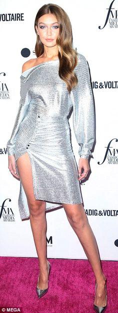 6e32a51662e7 Irina Shayk glitters in gold alongside Gigi Hadid and Hailey Baldwin