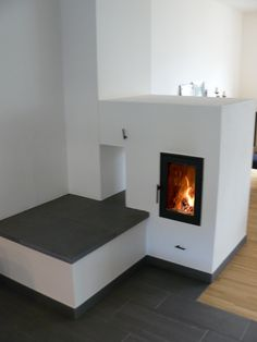 Very nice masonry heaters as room dividers offer view of the fire from 2 sides, tunnel solution images