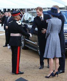 Princes Harry looked in good spirits as he arrived with William and Kateahead of the unve...