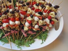 Antipasto skewer: use the small mozz balls and their juice. needed 2 artichoke cans, 2 olive cans, one pkg salami, 2 jars mozz, 1.5 packages tomato