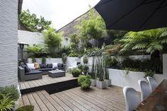 isoler la terrasse avec des bambous dans de grands bacs sur roulettes ?