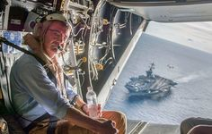 USS Theodore Roosevelt (CVN-71) in the background as Secretary of Defense Ash Carter flies in a V-22 Osprey on Nov. 5, 2015. DoD Photo