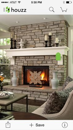 Our fireplace isn't raised, but the brick with the wood mantel is a nice detail.