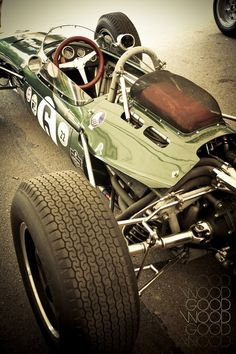 Formula 1 - late 1960s Green dramatic open wheel rear cockpit metal engine mechanical tyre racing vintage sport