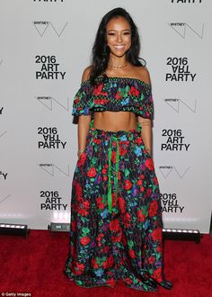 Bared some skin: Karrueche Tran opted for a vivid floral number that featured an off-the-s...