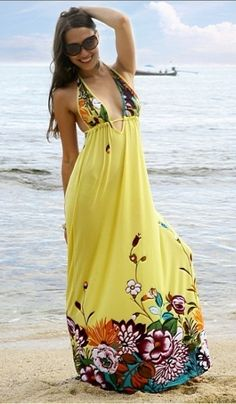 Knock out sensational yellow with English flowers arranged round the hem line and bust, tied in a halterneck around the neck and with a back strap tie under bust you control the support and style . Show your sunny sexy side this season with Bella