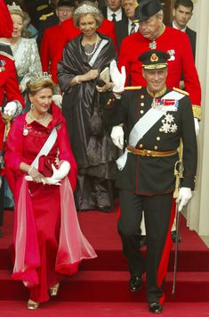 Norwegian King Harald V and Queen Sonja wave as they leave Copenhagen Cathedral after the wedding ceremony between Danish Crown Prince Frederik and his bride Crown Princess Mary on May 14, 2004 in Copenhagen, Denmark. Followed by Queen Sophia de Spain, and Queen Beatrix of the Netherlands