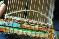 Using scraps of thick fabric(I can usually find them in fabric sample books at thrift stores) help little weavers fill the loom just a little faster and adds interesting contrast between the yarn and fabric...