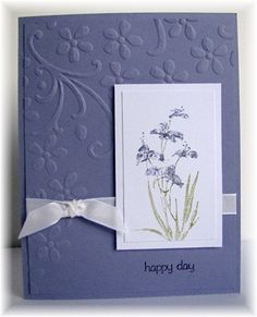 I like the embossing and layout of this card at Scrappin' and Stampin' in GJ