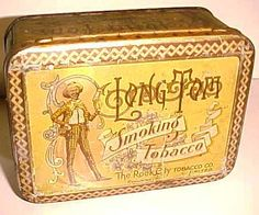 LONG TOM SMOKING TOBACCO TIN from the Rock City Tobacco Co. Limited. Tin was made by MacDonald Mfg. Co. Limited Toronto. Pictures a black man holding a plug of tobacco.