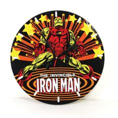 Marvel Comics: Iron Man Glass Clock- Industrialist, billionaire, original Avenger, one-time head of S.H.I.E.L.D.-- You want Iron Man in your corner... or on your wall! This stunning glass clock features a classic Silver Age Iron Man, as seen on Iron Man #1 from May 1968, wearing his best-known armor.
