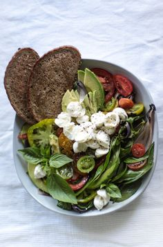 Beautiful Summer Caprice salad bowl with organic tomatoes, basil and mini buffalo mozzarella balls.