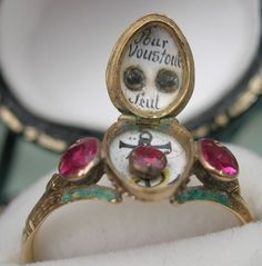 "Inside the locket bezel: 18th Century French Ring with enamel carnival mask. Inside is the message ""Pour Vous Tout Seule"" (""For You All Alone"")"