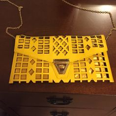 NWOT yellow clutch Never used. Purchased from Charmin Charlie's. Yellow. Detachable gold chain to wear as a shoulder purse. 11 1/2 inches wide. 6 inches vertically Charming Charlie Bags Clutches & Wristlets