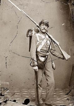Unidentified Union volunteer with shouldered rifle and bayonet in photographer's studio