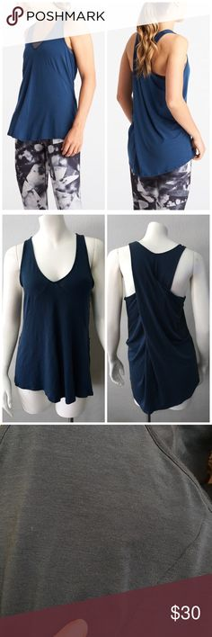 LUCY GIVE ME OM SLEEVELESS DEEP LAGOON TOP SHIRT L LUCY GIVE ME OM SLEEVELESS DEEP LAGOON TOP SHIRT SZ L - ONE VERY TINY RUN THAT YOU DON'T REALLY NOTICE BUT I WANTED TO NOTE IT TO BE THOROUGH Lucy Tops Tank Tops