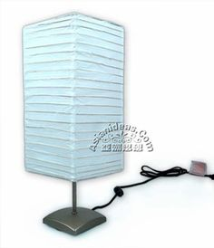 """Today's feature product: Natsu Table Lamp  Classic rice paper lantern over a contemporary lamp base, this elegant table lamp will glow with a magical warmth and add a pleasant atmosphere to any room. Facts and features:  • collapsible rectangular rice paper lantern  • brushed nickel lamp base with metal expander  • approx: 7"""" l x 7"""" w x 19.5"""" height   • some assembly required   • weighs 1.95 pound (0.9 kg)  http://www.asianideas.com/shojilamp2.html"""