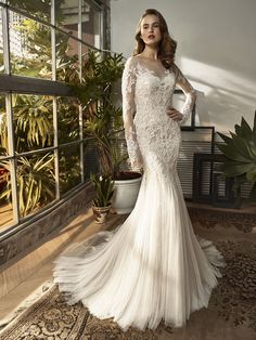 b357a7a72812 Wedding Dress out of Beautiful A knockout gown with two gorgeous looks in  one. features a sleek and soft Chantilly overlace mermaid gown with a low  back ...