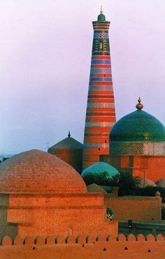 Huja Madrasah and Minaret, Uzbekistan. Khiva's newest Islamic monuments, both built in 1910. The 45 meters tall minaret is the tallest in Khiva. The madrasah holds Khiva's best museum of Khorezm handicrafts through the ages, fine wood carving, metalwork, jewelery, books, Uzbek and Turkmen carpets, pottery etc. Islam Huja himself was an early 20th century grand vizier. He founded a European style school brought long-distance telegraph to the city and built a hospital. (V)