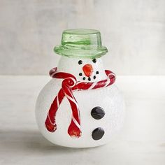 A snowman that's crafted with love and won't melt? Our adorable art glass figurine is handblown and dapperly attired in standard snow-fella tradition of a scarf, buttons and sparkly top hat.